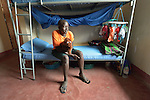 A student sits on her bed at the Loreto Secondary School in Rumbek, South Sudan. The school is run by the Institute for the Blessed Virgin Mary--the Loreto Sisters--of Ireland.
