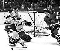 Seals vs BlackHawks: Seals Ray McKay and Hawks #20 Cliff Korall.  (1971 photo by Ron Riesterer)