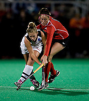 Katie O'Donnell (16) of Maryland tries to get past Aisling McKeon (6) of Ohio State during the NCAA Field Hockey Championship semfinals in College Park, MD.  Maryland defeated Ohio State, 3-1.
