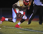 Oxford High vs. Lafayette High's Brandon Mack (4) picks up a fumble at Bobby Holcomb Field in Oxford, Miss. on Thursday, August 30, 2012. Oxford High won 19-0.