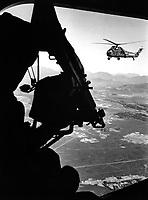 Vietnam:  helicopter and soldier approaching target.  Ca. 1965.<br /> EXACT DATE SHOT UNKNOWN<br /> NARA FILE #:  306-PSC-65-4106<br /> WAR &amp; CONFLICT BOOK #:  402