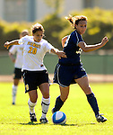 2 September 2007: University of Vermont Catamounts' Kaitlin Francis (20), a Junior from Hinesburg, VT, battles George Washington University Colonials' Kristen Slack (33), a Freshman from Northville, MI at Historic Centennial Field in Burlington, Vermont. The Colonials rallied to defeat the Catamounts 2-1 in overtime during the TD Banknorth Soccer Classic...Mandatory Photo Credit: Ed Wolfstein Photo