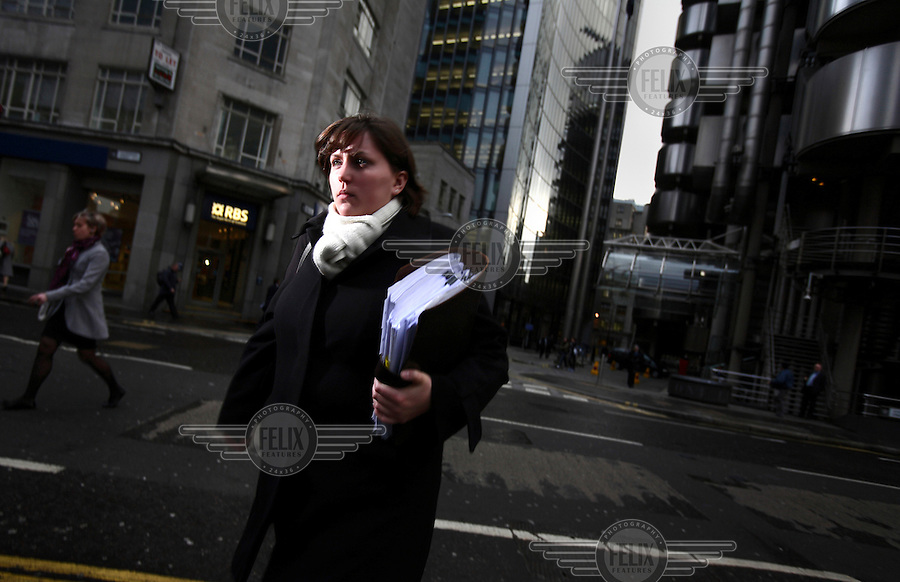 Emma, who works as a broker in the City of London, pictured outside a branch of Royal Bank of Scotland (RBS), which had to be bailed out by the government. The UK went into recession in the final quarter of 2008 as the City was hit hard by the global credit crunch.