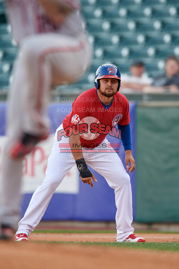 Buffalo Bisons first baseman Rowdy Tellez (21) leads off first base as pitcher Greg Ross delivers a pitch during a game against the Syracuse Chiefs on May 18, 2017 at Coca-Cola Field in Buffalo, New York.  Buffalo defeated Syracuse 4-3.  (Mike Janes/Four Seam Images)
