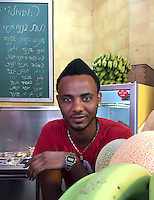 20. &quot;African at juice bar&quot;:  Tel Aviv.<br /> <br /> Many thousands of Ethiopian Jews, as well as other African refugees and asylum seekers, have immigrated to Israel. Yet ongoing discrimination has kept many of them on the periphery of Israeli society. However, this young man seems to have avoided such difficulties, at least on the surface. He is working at a juice bar in Tel Aviv, and looks relaxed and well off with his sporty watch, earing, golden necklace and beatific expression.