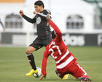 Cristian Castillo #12 of D.C. United has the ball taken away by Edson Edwards #27 of F.C. Dallas during a US Open Cup match on April 28 2010, at RFK Stadium in Washington D.C. United won 4-2.