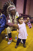 Tribe elder Mark Soldier Wolf greets his granddaughter Blue Moccasin Soldier Wolf, 2, at the inauguration of a new language immersion school on the Wind River Indian Reservation in central Wyoming, Friday, Oct. 3, 2008. Northern Arapaho tribal leaders hope the inauguration of the larger new Arapaho Language Lodge immersion school at the reservation will help kids find a better cultural identity and strengthen them better succeed in education. (Kevin Moloney for the New York Times)