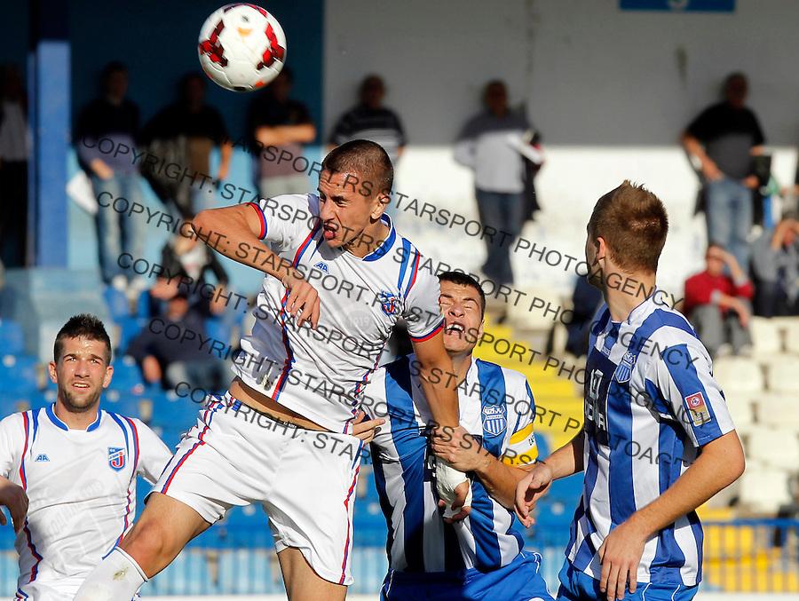 Fudbal Super liga season 2013-2014<br /> Ofk Beograd v Jagodina<br /> Aleksandar Pesic (L) and Nikola Vasiljevic<br /> Beograd, 09.11.2013.<br /> foto: Srdjan Stevanovic/Starsportphoto &copy;