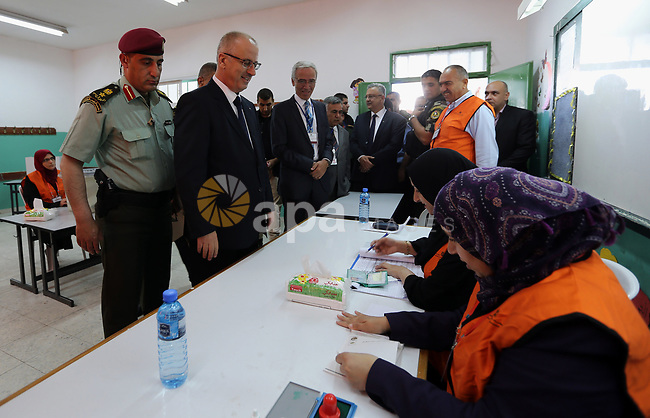 Palestinian Prime Minister Rami Hamdallah arrives to cast his ballot at a polling station during municipal elections in the northern West Bank town of Anabta, near Tulkarm May 13, 2017. Photo by Prime Minister Office
