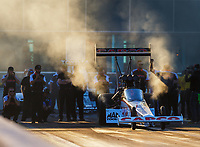 Mar 17, 2017; Gainesville , FL, USA; Crew member Bob Lagana (right) hits the rear wing on the dragster of NHRA top fuel driver Steve Torrence as he prepares t race during qualifying for the Gatornationals at Gainesville Raceway. Mandatory Credit: Mark J. Rebilas-USA TODAY Sports