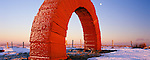 Andy Goldsworthy sculpture art in landscape Striding Arches at Glenhead near Moniaive Dumfries and Galloway Scotland UK A arch on Colt Hill in the winter snow catching the sunset light