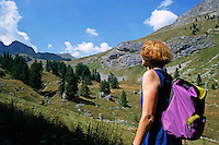 Woman hiker looking out over the mountainous landscape.