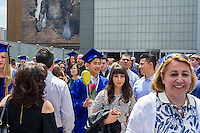 Graduating students from the Fashion Institute of Technology with their friends and families leave Jacob Javits Convention Center in New York on Thursday, May 19, 2016 after the college's commencement exercises.  (© Richard B. Levine)