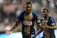 Jose Kleberson (19) of the Philadelphia Union celebrates scoring the game winning goal with Raymon Gaddis (28) in second half stoppage time. The Philadelphia Union defeated Toronto FC 1-0 during a Major League Soccer (MLS) match at PPL Park in Chester, PA, on October 5, 2013.