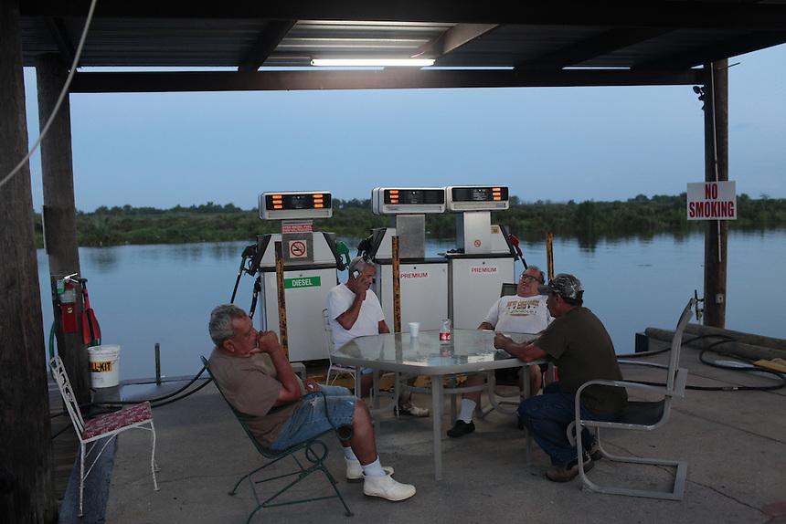Lionel Serigne sits with friends at Delacroix Island, LA on August 30, 2010.
