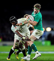 Jamie Heaslip of Ireland looks to fend Maro Itoje of England. RBS Six Nations match between England and Ireland on February 27, 2016 at Twickenham Stadium in London, England. Photo by: Patrick Khachfe / Onside Images