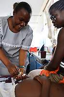 A nurse inserting a canula into a childs hand, Ola During Hospital, Freetown, Sierra Leone. A nurse inserting a canula into a childs hand, Ola During Hospital, Freetown, Sierra Leone. The Welbodi Partnership works to support the Ministry of Health and Sanitation in Sierra Leone to deliver high quality paediatric care.  The work of the charity is designed to stimulate lasting change, whether through one-time investments with long-term benefits, or ongoing engagement around key issues, and the charity's long-term commitment is reflected in its approach to funding - their aim is to establish an endowment fund for the hospitals with which they work..The charity's work is conceived, designed, led and implemented by local partners. Hospital staff in Sierra Leone often already know the best solutions to the numerous problems they face, and where they don't, they are the best judges of new ideas. So the role of the Welbodi Partnership is to coordinate funding, international expertise and local know-how to facilitate improvements in the delivery of health care.  They also work to build relationships and consensus with leaders within the Government of Sierra Leone, local health facilities, donors, NGOs and international partners..Welbodi Partnership works to instil a culture of innovation and excellence with partners and their team of experts. They constantly question the assumptions that underlie their work and the tools that they use, evaluate their efficacy and adapt what they do appropriately.