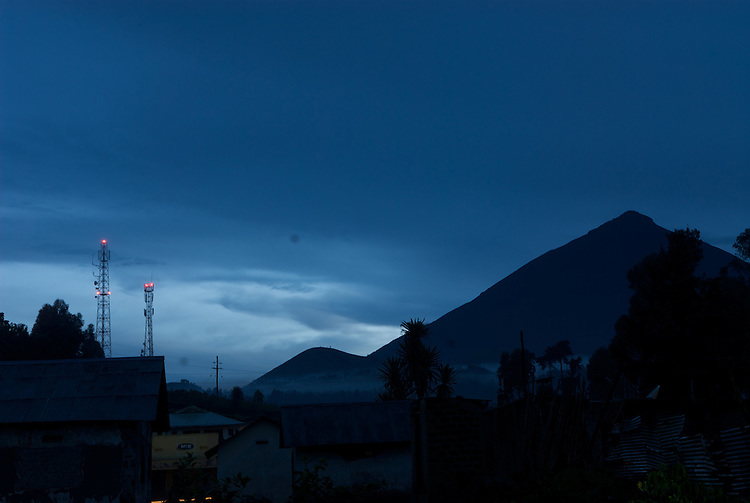 Mobile masts over Kisoro at dusk. The cone of XXX volcano behind. This is junction of the borders of Uganda, Rwanda and DR Congo.