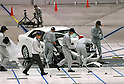 "July 21st, 2011, Susonosi, Japan - Toyota technicians checks a badly damaged Crown after a head-on collision with a Toyota VITZ at the speed of 55km/h (about 34 miles/h) in a demonstration at Toyotas Higashi-Fuji Technical Center on the foot of Mt. Fuji, some 92km (about 57 miles) southwest of Tokyo, on Thursday, July 21, 2011. Toyota showed to reporters technologies aimed at increasing safety for pedestrians and elderly drivers, as part of its initiatives to eliminate traffic casualties. The technologies include a Pre-Collision System with collision-avoidance assist, glare-preventing adaptive driving beams and a pop-up hood for lessening pedestrian injury. In the PCS, Toyota uses cameras and a super sensitive radar called ""millimeter-wave,"" both installed in the front of the vehicle, to detect possible crashes such as a pedestrian crossing the road. Then the vehicle calculates how braking and steering must be applied to avoid a crash. (Photo by Natsuki Sakai/AFLO) [3615] -mis-"