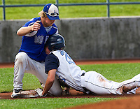 "The Laurel Dodgers third baseman #14 Clay Graber tags out a runner during play against the Kennewick Junior Bandits in the championship game of the American Legion Northwest Class ""A"" Regional Tournament.The Bandits took first place with a score of 7-6 after 9 innings of play at Kearns Gates Field in Kearn Utah Tuesday, Aug. 11, 2009. August Miller"