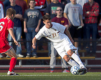 Boston College midfielder/defender Colin Murphy (21) controls the ball at midfield.  Rutgers University defeated Boston College in penalty kicks after two overtime periods in NCAA Division I tournament action, at Newton Campus Field, November 20, 2011.