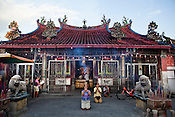 Devout Chinese pray at the Goddess of Mercy temple in capital Georgetown of Penang, Malaysia. Photo: Sanjit Das/Panos