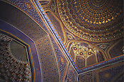 The ornately decorated ceiling in the Tilla-Kari Medressa, once an important Islamic studies teaching school on the Old Silk Road, now a tourist attraction in Registan Square, Samarkand, Uzbekistan.
