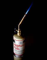 PROPANE TORCH<br /> C3H8 Burns In Air Producing A Blue Flame<br /> Propane is a liquid at 25' C under high pressure. When liquid propane is released from its storage tank, the pressure on it is lower and it changes to a gas.