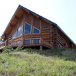 This is a large log home located on Bear Mountain over looking Lake Chelan.