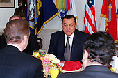 Washington, DC - March 30, 2000 -- United States Secretary of Defense William S. Cohen (left foreground) hosts a working breakfast with visiting President Hosni Mubarak of Egypt (center) at the Pentagon, March 30, 2000.  Joining the senior Department of Defense officials present were four prominent U.S. senators.  Under discussion were a broad range of regional security issues.                                   .Mandatory Credit: Robert D. Ward / DoD via CNP..