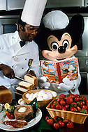 Orlando, Florida - Circa 1986. Mickey Mouse teaches Disney World staff how to cook. Disney World is a world-renowned entertainment complex that opened October 1, 1971 in Lake Buena Vista, FL. Now known as the Walt Disney World Resort, the property covers 25,000 acres and has an annual attendance of 52.5million people.