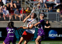 Laura Merrifield (9) of Maryland is fouled as she moves to the goal by Jessica Russo (23)  and Alexandra Frank (11) of Northwestern during the NCAA Championship held in Johnny Unitas Stadium at Towson University in Towson, MD.  Maryland defeated Northwestern, 13-11, to win the title.