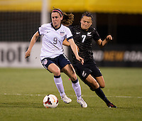 Heather O'Reilly (9) of the USWNT sprints away from Ali Riley (7) during an international friendly at Crew Stadium in Columbus, OH. The USWNT tied New Zealand, 1-1.