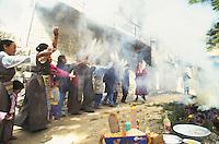 Tibetans throwing tsampa (flour), during Losar the Tibetan New Year.