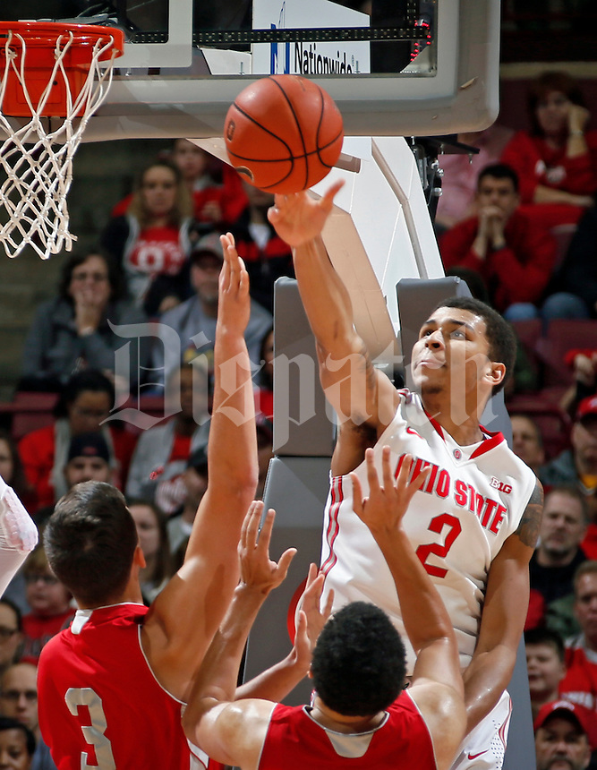 Ohio State Buckeyes forward Marc Loving (2) blocks the shot of Sacred Heart Pioneers center Cole Walton (3) during the 1st half of their NCAA game at Value City Arena in Columbus, Ohio on November 23, 2014.  (Dispatch photo by Kyle Robertson)