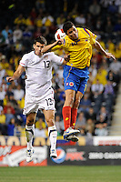 Eric Lichaj (13) of the United States (USA) and Giovanni Moreno (10) of Colombia (COL) go up for a header. The men's national teams of the United States (USA) and Colombia (COL) played to a 0-0 tie during an international friendly at PPL Park in Chester, PA, on October 12, 2010.