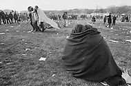 15 Nov 1969, Washington, DC, USA --- Protestors of the Vietnam War huddling in a blanket at the end of the Peace Moratorium on the Mall in Washington, DC on November 15, 1969. The Peace Moratorium 2nd is believed to have been the largest demonstration in US history with an estimated 20 to 30 million people involved. --- Image by © JP Laffont/Sygma/CORBIS