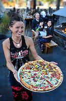 Waitress Sadie Evans with Pizza,Ten Barrel Brewing Company, Beer Garden in autumn,Bend,Oregon,USA.Model release nr.0156,O165,O164)