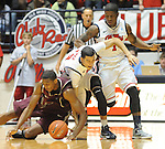 "Arkansas Little Rock's James White (33), Mississippi's Anthony Perez (13), and Mississippi's Martavious Newby (1) go for the ball at the C.M. ""Tad"" Smith Coliseum in Oxford, Miss. on Friday, November 16, 2012. (AP Photo/Oxford Eagle, Bruce Newman)"