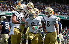 Sept. 1, 2012; Notre Dame running back Theo Riddick celebrates his first quarter touchdown with teammates in the 2012 Emerald Isle Classic against Navy at Aviva Stadium in Dublin, Ireland. Photo by Barbara Johnston/University of Notre Dame