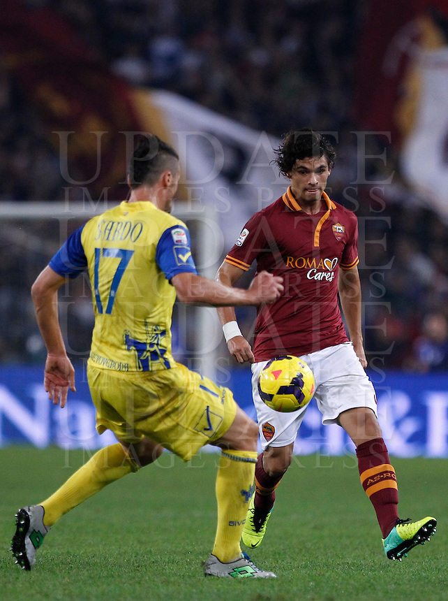 Calcio, Serie A: Roma vs ChievoVerona. Roma, stadio Olimpico, 31 ottobre 2013.<br /> AS Roma defender Dodo', of Brazil, is challenged by ChievoVerona defender Gennaro Sardo, left, during the Italian Serie A football match between AS Roma and ChievoVerona at Rome's Olympic stadium, 31 October 2013.<br /> UPDATE IMAGES PRESS/Isabella Bonotto