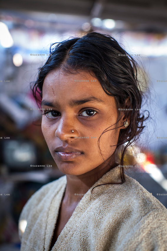 Meera poses for a portrait in the small shelter that she lives in with her family in Varanasi, Uttar Pradesh, India on 19 November 2013.