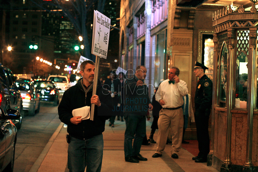 Flutist Jim Zellers pickets the Fox Theatre with other members of the Atlanta Ballet Orchestra during a performance of &quot;The Nutcracker.&quot; Last summer the Atlanta Ballet announced it would begin using recorded music for all of its productions and fired the orchestra. The American Federation of Musicians Local 148-462 has filed an unfair labor practice complaint. (Contact info: Mary Kenney of the orchestra (404) 888-0787)<br />