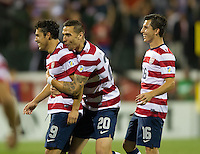 Columbus, Ohio - Tuesday, September 11, 2012: The USA defeated Jamaica 1-0 in the first round of World Cup Qualifying at Columbus Crew Stadium. Herculez Gomez celebrates his goal with Geoff Cameron and Jose Torres.