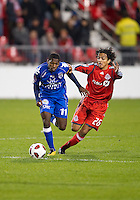 19 October 2010: Toronto FC Oscar Cordon #26 battles with Arabe Unido Armando Cooper #11 during a CONCACAF game between Arabe Unido and Toronto FC at BMO Field in Toronto..Toronto FC won 1-0..