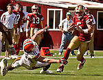 Cleveland Browns linebacker Ben Taylor (58)  attempts to stop San Francisco 49ers quarterback Jeff Garcia (5) on Sunday, September 21, 2003, in San Francisco, California. The Browns defeated the 49ers 13-12.