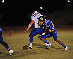 Oxford High's Aundrei Turner (83) chases the ball after a blocked punt vs. Saltillo in Oxford, Miss. on Friday, October 19, 2012. Oxford won to improve to 9-0.