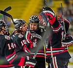 17 December 2013:  The Northeastern University Huskies celebrate their first goal against the University of Vermont Catamounts at Gutterson Fieldhouse in Burlington, Vermont. The Huskies shut out the Catamounts 3-0 to end UVM's 5 game winning streak. Mandatory Credit: Ed Wolfstein Photo *** RAW (NEF) Image File Available ***