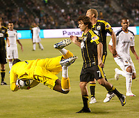 Galaxy goalie Donovan Ricketts (1) dives to make a save during the first half of the game between LA Galaxy and the Columbus Crew at the Home Depot Center in Carson, CA, on September 11, 2010. LA Galaxy 3, Columbus Crew 1.