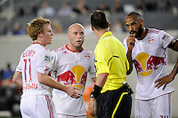 Dax McCarty (11), Luke Rodgers (9) and Thierry Henry (14) of the New York Red Bulls question referee Geoff Gamble waving off a goal just before the half. The New York Red Bulls defeated Toronto FC 5-0 during a Major League Soccer (MLS) match at Red Bull Arena in Harrison, NJ, on July 06, 2011.